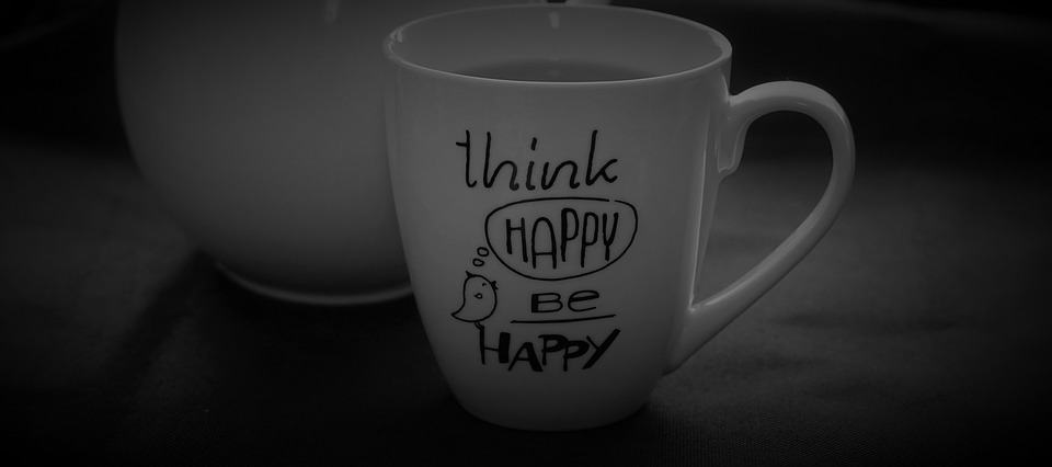 cup with writing on that says think happy be happy
