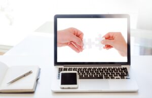 computer with an image of one hand helping another when you share your products